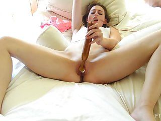 Danni makes sure she is in a comfortable position while masturbating