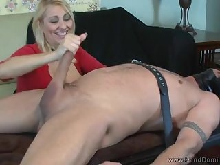 A full-bosomed senior woman strokes a knob and rides it