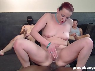 Gangbang aloft the floor with a lot be required of guys added to a redhead babe
