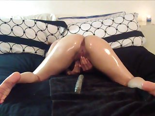 Naughty webcam model oils up for some hot merely play