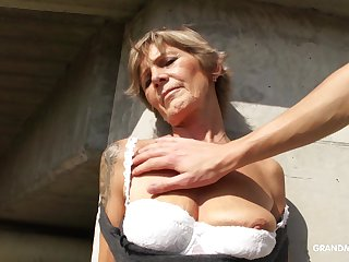 Naughty mature whore exposes her tits coupled with gives nice head